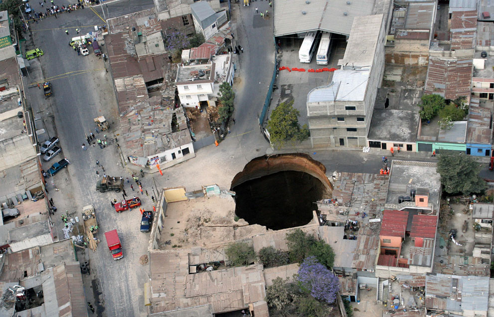 Aerial view of a huge hole caused after a collapse in the sewage system in the neighborhood of San Antonio, north of Guatemala city, on February 23, 2007. Three people were killed in the collapse, as twelve homes were swallowed up.