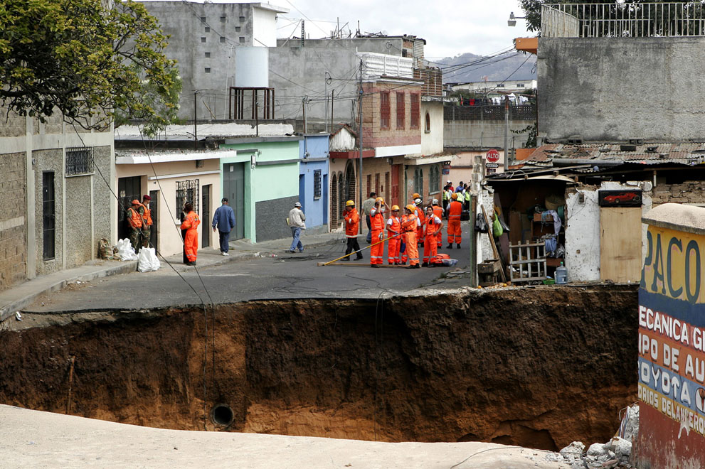 A hole remains where a structure once stood in Guatemala City, on February 23, 2007. A giant sinkhole swallowed several homes killing at least three people, officials said.