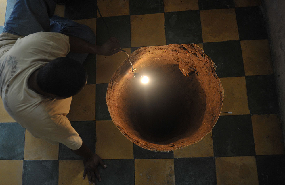 A man inspects a sinkhole formed in a house on July 19, 2011 in the north of Guatemala City. When neighbors heard a loud boom overnight they thought a gas canister had detonated. Instead they found a deep sinkhole inside a home in a neighborhood just north of Guatemala City. The sinkhole was 12.2 meters (40 feet) deep and 80 centimeters (32 inches) in diameter, an AFP journalist who visited the site reported. Guatemala City, built on volcanic deposits, is especially prone to sinkholes, often blamed on a leaky sewer system or on heavy rain.