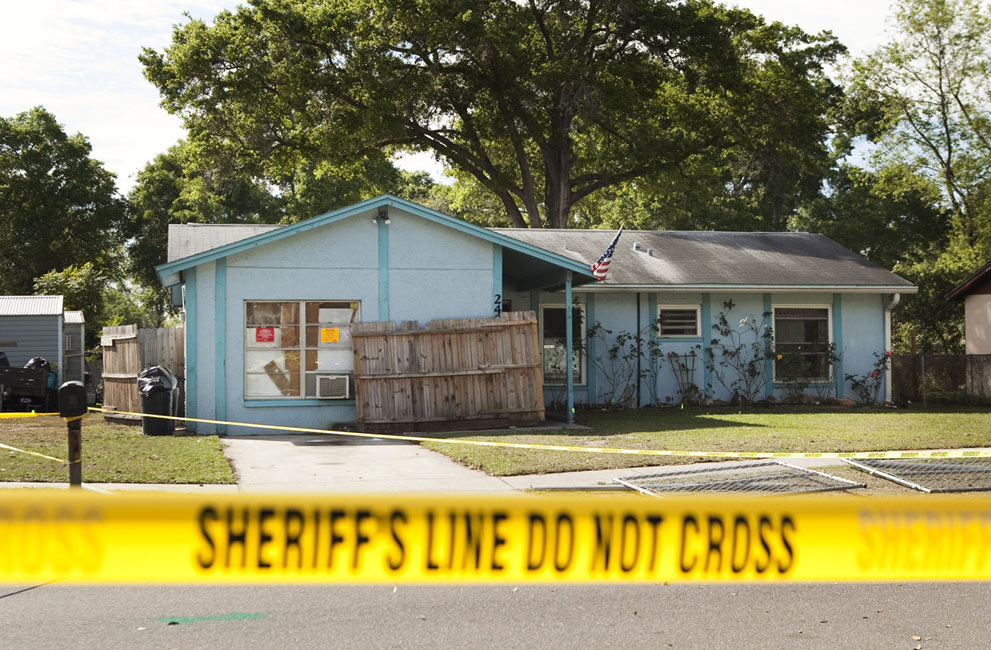 Police tape surrounds the house of Jeff Bush, who was consumed by a sinkhole while lying in his bed on the night of April 30, 2013 in Seffner, Florida. First responders were not able to reach Bush after he disappeared and were unable to even recover the body. The house and two neighboring houses were later demolished.