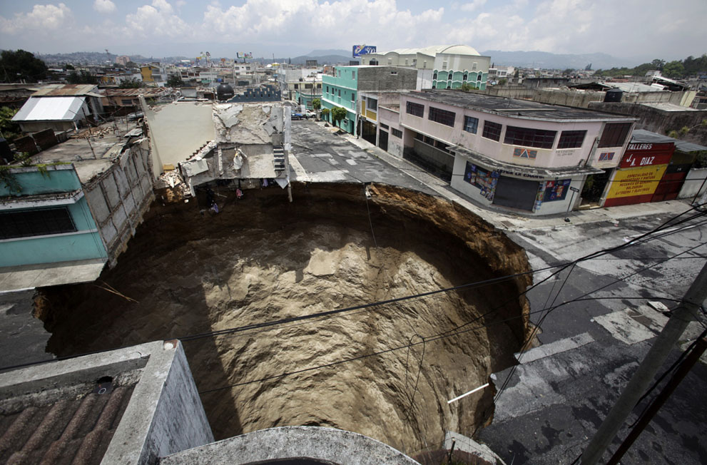 A giant sinkhole caused by the rains of tropical storm Agatha, in Guatemala City, on June 1, 2010. The hole swallowed at least one three-story building.