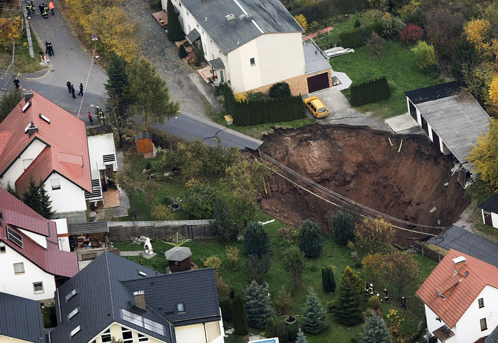 A large crater that appeared in the early hours in the German town of Schmalkalden, on November 1, 2010.